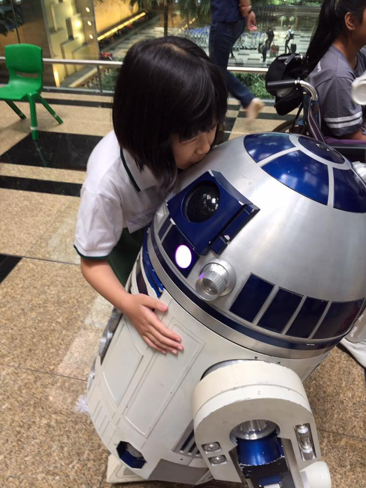 Ashley kissing R2-D2.