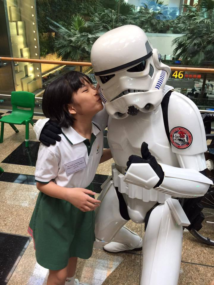 Ashley kissing a Stormtrooper from the 501st Singapore Garrison.
