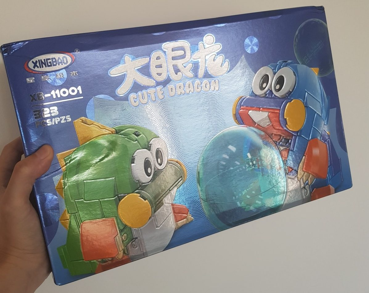 geek review xingbao puzzle bobble xb 11001 cute dragon by arvo