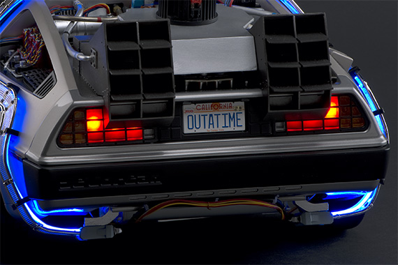 The brake lights at the rear of the car come on when you press down on the brake pedal.