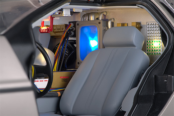 The interior of the cabin features a light up version of the flux capacitor, folding seats, and numerous lights.