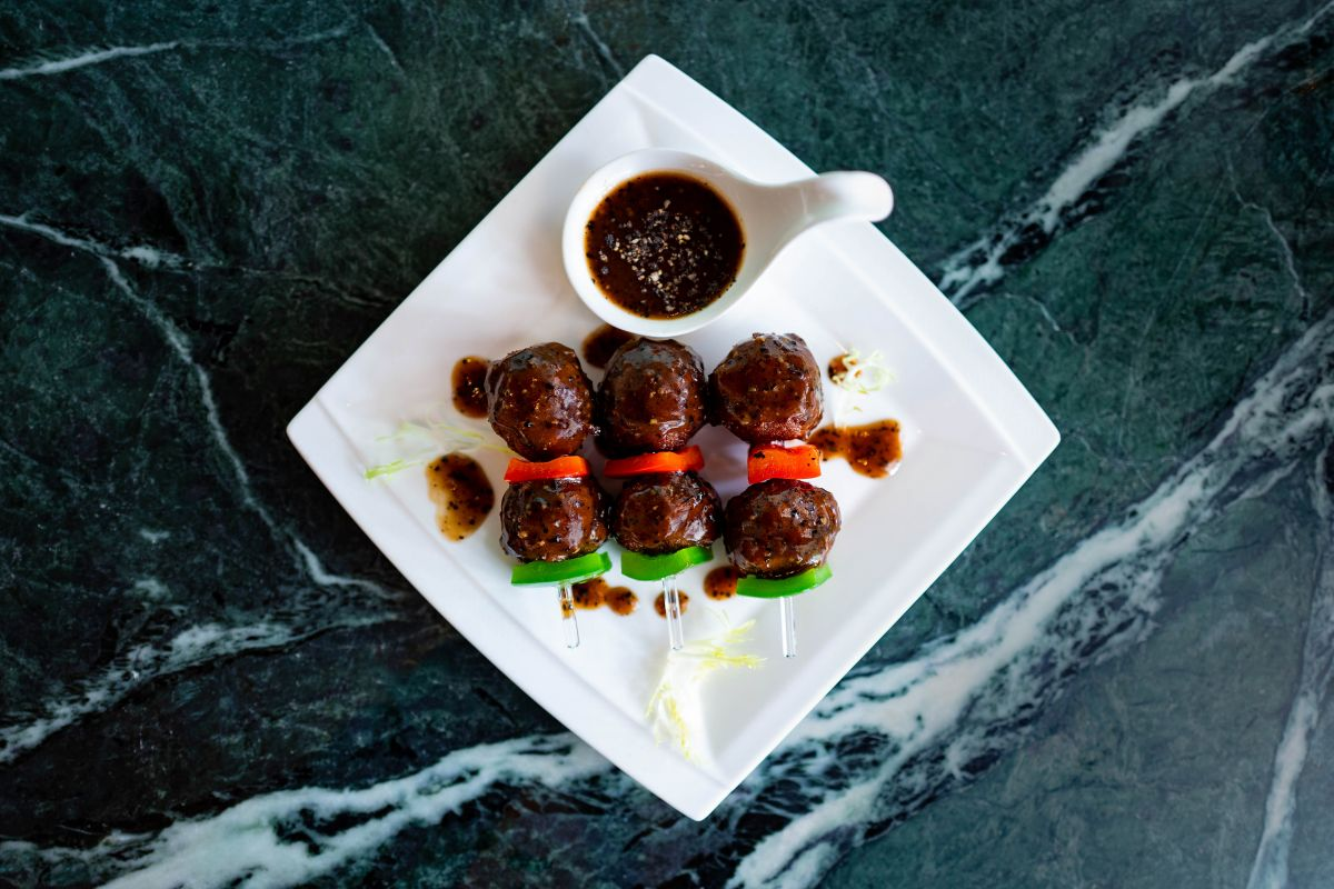 Black Pepper Impossible Meatball Skewers by Empress