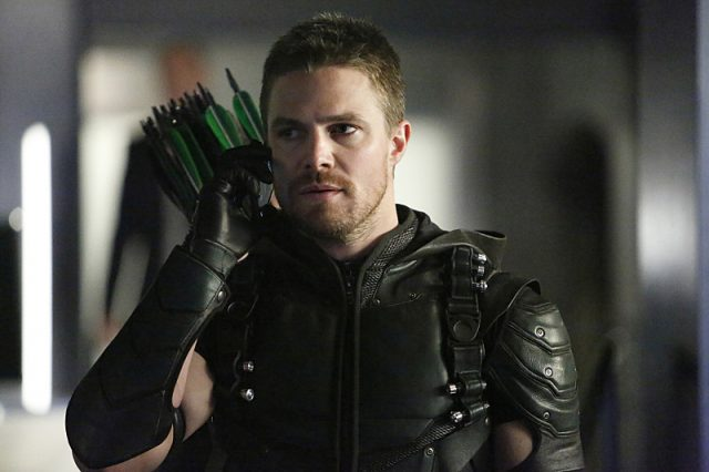 Stephen Amell as Oliver Queen/Green Arrow.